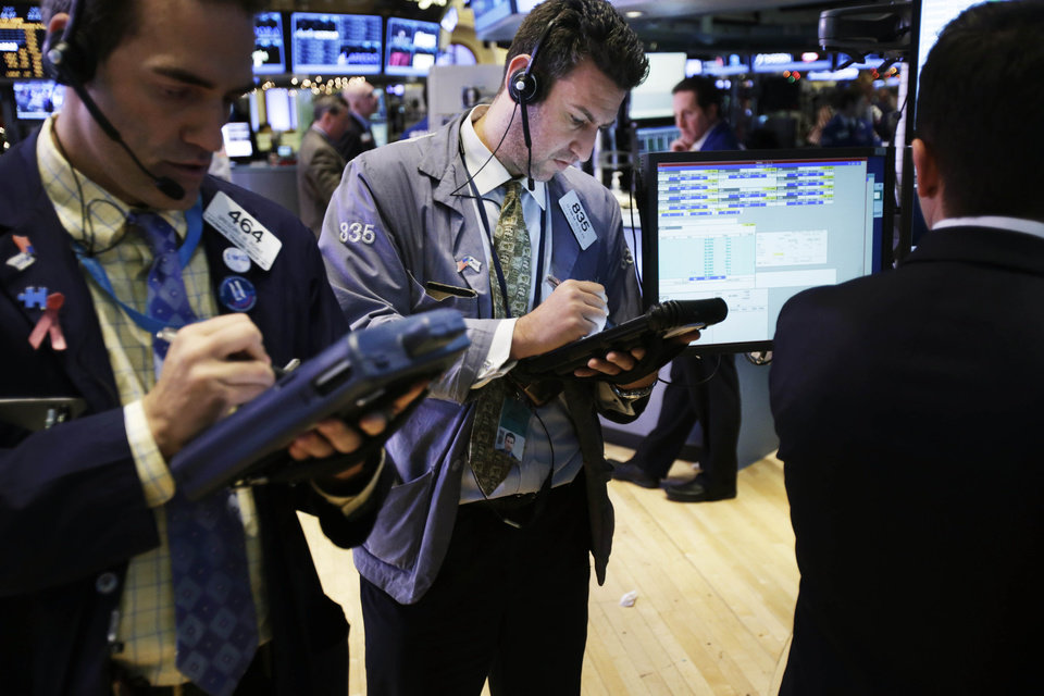 Photo - Traders work on the floor at the New York Stock Exchange in New York, Friday, Dec. 28, 2012. Stocks were heading lower Friday, for a fifth day, on concern that Washington lawmakers will fail to reach a budget deal before a year-end deadline. (AP Photo/Seth Wenig)
