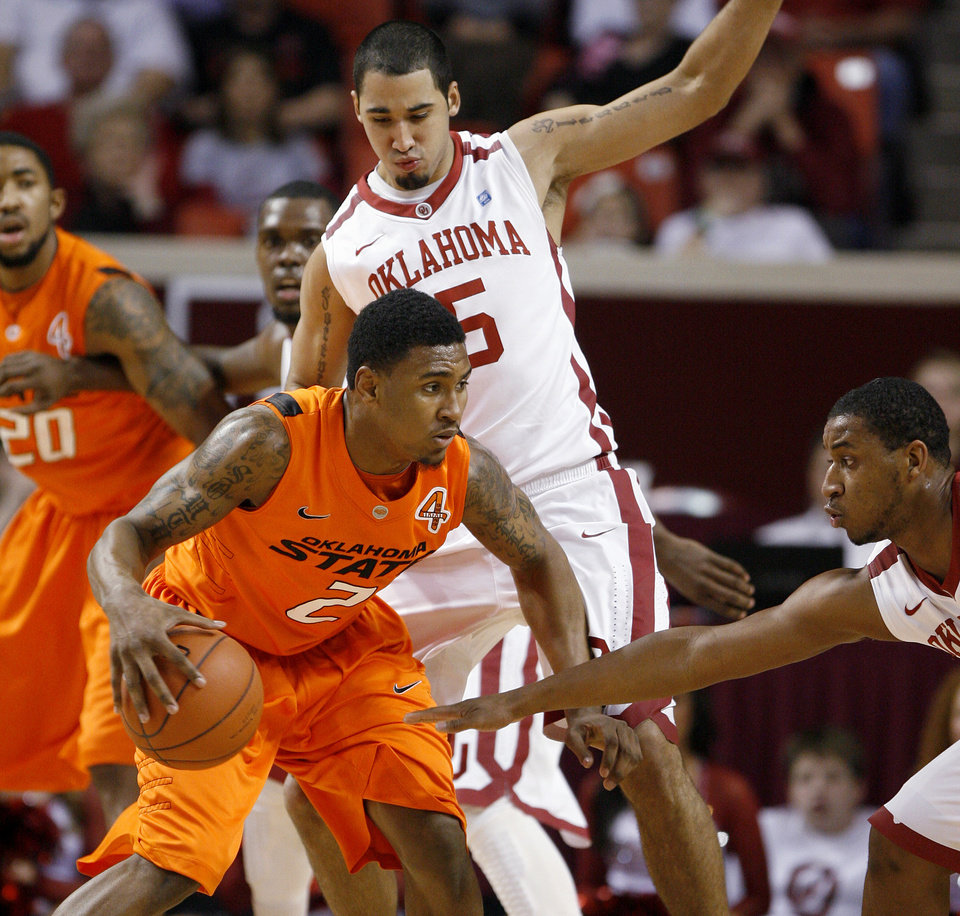 Oklahoma's C.J. Washington (5) and Steven Pledger (2) defend Oklahoma State's Le'Bryan Nash (2) during the Bedlam men's college basketball game between the University of Oklahoma Sooners and the Oklahoma State Cowboys in Norman, Okla., Wednesday, Feb. 22, 2012. Oklahoma won 77-64. Photo by Bryan Terry, The Oklahoman