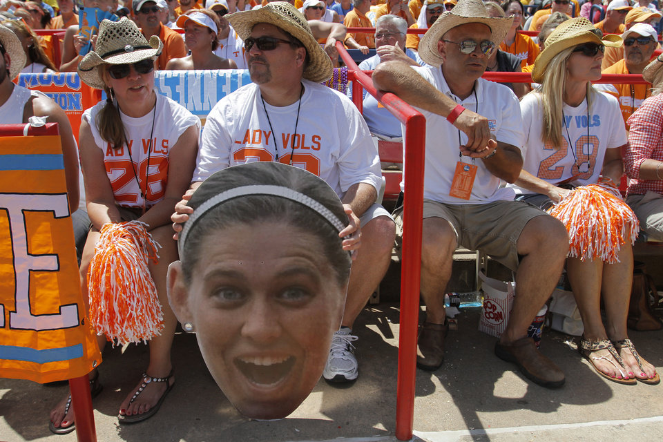 Greg Smith holds a cutout of Tennessee's Shelby Virgil (28) during a Women's College World Series game between Tennessee and Oregon at ASA Hall of Fame Stadium in Oklahoma City, Saturday, June 2, 2012.  Photo by Garett Fisbeck, The Oklahoman