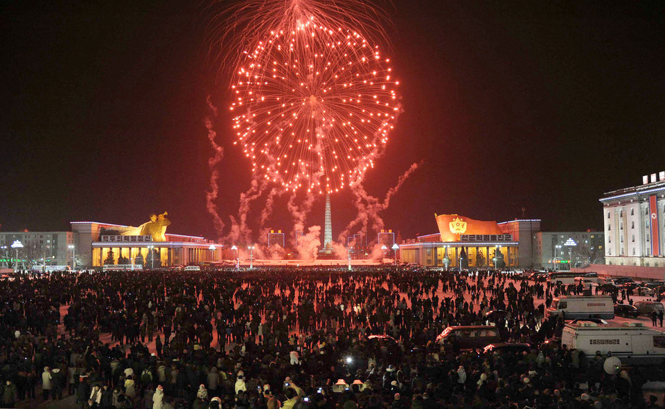 Photo - Fireworks explode over Kim Il Sung Square in celebration of the New Year in Pyongyang, North Korea, Tuesday, Jan. 1, 2013. North Korean leader Kim Jong Un on Tuesday called for improving the economy and living standards of his impoverished nation with the same urgency that scientists showed in successfully testing a long-range rocket recently. (AP Photo/Kyodo News) JAPAN OUT, MANDATORY CREDIT, NO LICENSING IN CHINA, HONG KONG, JAPAN, SOUTH KOREA AND FRANCE