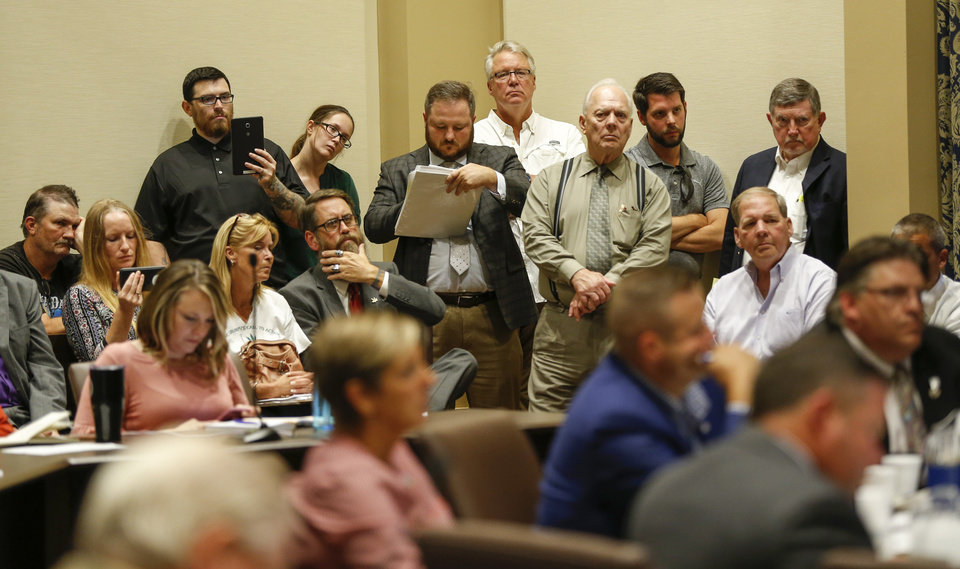 Photo - People listen during the first meeting of the Medical Marijuana Working Group in room 535 of the state Capitol in Oklahoma City, Wednesday, July 25, 2018. Photo by Nate Billings, The Oklahoman
