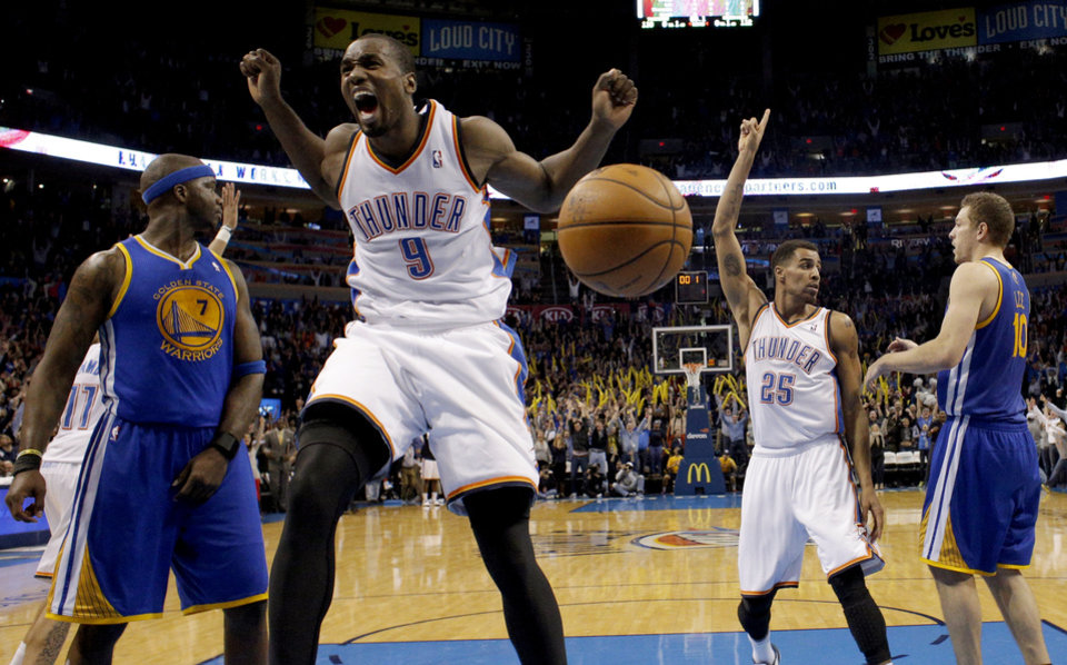 Photo - Oklahoma City's Serge Ibaka (9) celebrates Russell Westbrook's game-winning three pointer in the overtime of the NBA game between the Oklahoma City Thunder and the Golden State Warriors at the Chesapeake Energy Arena, Friday, Nov. 29, 2013. Photo by Sarah Phipps, The Oklahoman