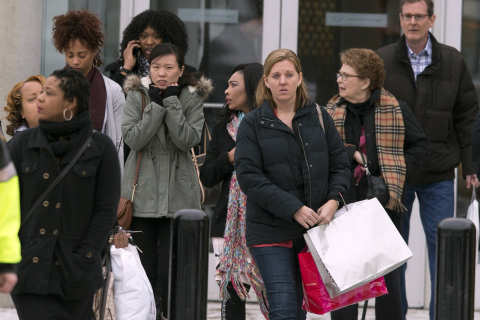 Photo - Shoppers are evacuated by police after a shooting at The Mall in Columbia on Saturday, Jan. 25, 2014, in Columbia, Md. Police say three people died in a shooting at the mall in suburban Baltimore, including the presumed gunman. (AP Photo/ Evan Vucci)