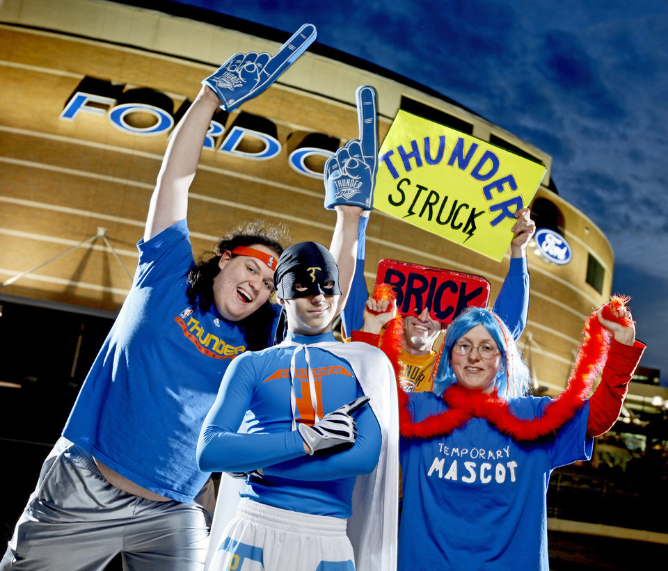 "Thunder super fans from left, Zeb Benbrook, ""Thunder Man"" Derrick Seys, and Angela Love pose for a portrait outside the Ford Center in Oklahoma City, Thursday, Feb. 12, 2009. PHOTO BY BRYAN TERRY, THE OKLAHOMAN"
