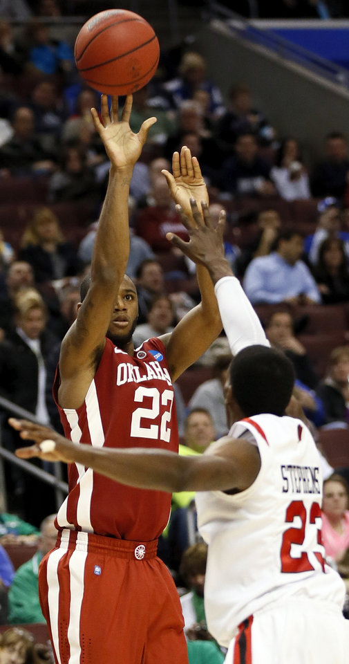 Photo - Oklahoma's Amath M'Baye (22) shoots against San Diego State's DeShawn Stephens (23) during a game between the University of Oklahoma and San Diego State in the second round of the NCAA men's college basketball tournament at the Wells Fargo Center in Philadelphia, Friday, March 22, 2013. Photo by Nate Billings, The Oklahoman