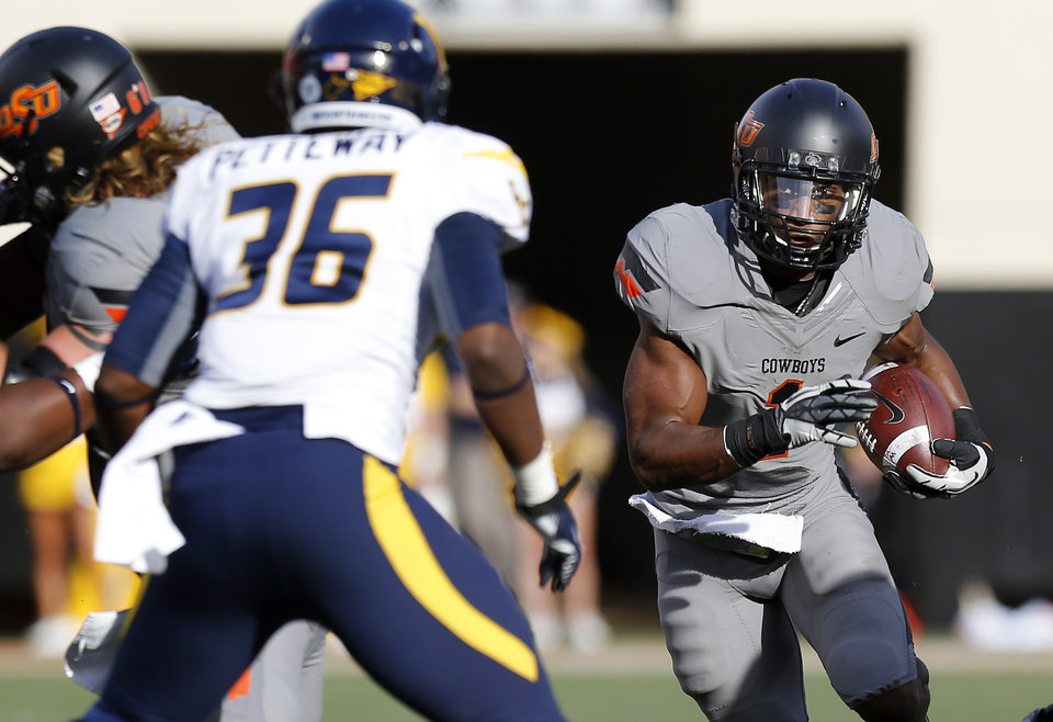 Photo - Oklahoma State's Joseph Randle (1) runs the ball during a college football game between Oklahoma State University (OSU) and West Virginia University at Boone Pickens Stadium in Stillwater, Okla., Saturday, Nov. 10, 2012. Oklahoma State won 55-34. Photo by Bryan Terry, The Oklahoman