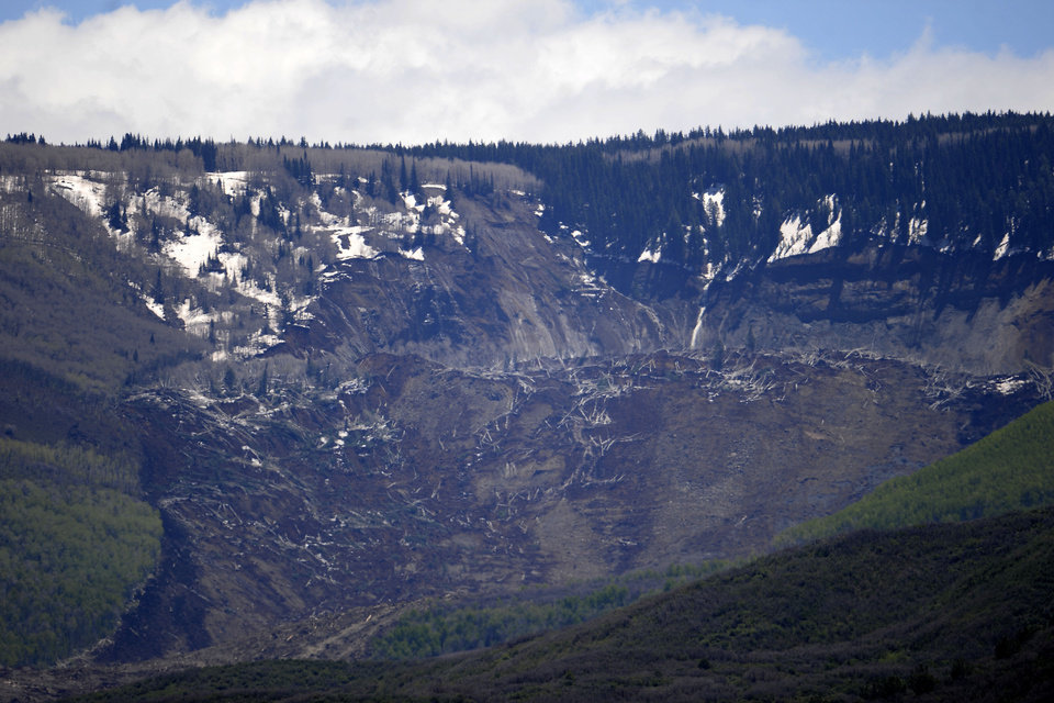 Photo - The aftermath of the Mesa County Mudslide is photographed from a plane, Monday, May 26, 2014, near Collbran, Colo. Rescue teams are searching for three men missing after a half-mile stretch of a ridge saturated with rain collapsed. (AP Photo/The Denver Post, AAron Ontiveroz) MAGS OUT; TV OUT; INTERNET OUT; NO SALES; NEW YORK POST OUT; NEW YORK DAILY NEWS OUT