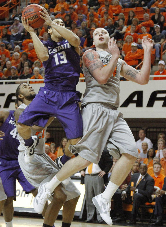 Photo - Kansas State's Angel Rodriguez (13) is fouled by Oklahoma State's Philip Jurick (44) during an NCAA college basketball game between the Oklahoma State University Cowboys (OSU) and the Kansas State University Wildcats (KSU) at Gallagher-Iba Arena in Stillwater, Okla., Saturday, Jan. 21, 2012. Photo by Bryan Terry, The Oklahoman
