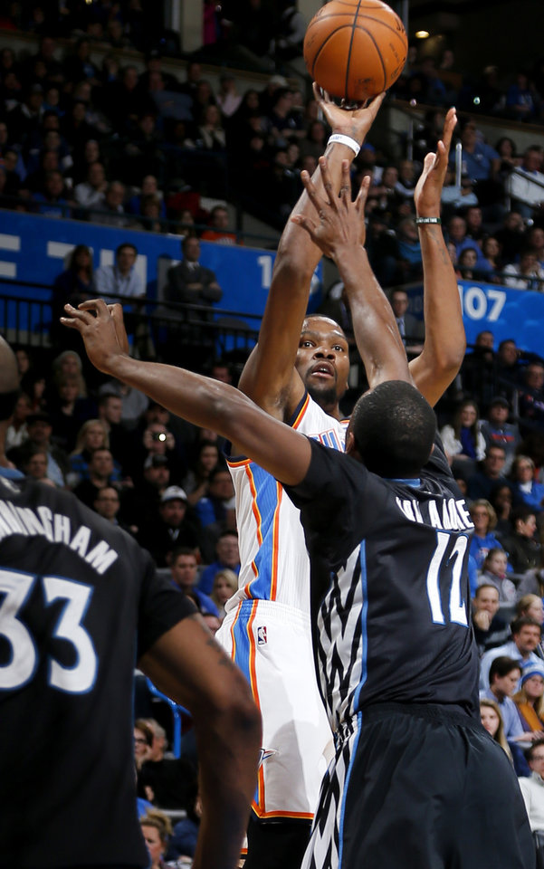 Photo - Oklahoma City's Kevin Durant (35) shoots over Minnesota's Luc Richard Mbah a Moute (12) during an NBA basketball game between the Oklahoma CIty Thunder and the Minnesota Timberwolves at Chesapeake Energy Arena in Oklahoma City, Wednesday, Feb. 5, 2014. Oklahoma City won 106-97. Photo by Bryan Terry, The Oklahoman