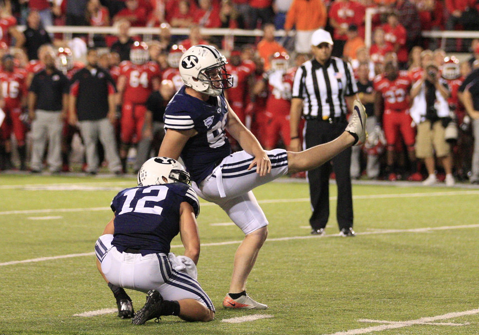 Photo -   BYU's JD Falslev (12) looks on as BYU Riley Stephenson (99) misses his field goal at the end of their NCAA football game with Utah Saturday, Sept. 15, 2012, in Salt Lake City. Utah defeated BYU 24-21. Stephenson's 36-yard attempt with no time left clanked off the left upright, sending the frenzied crowd back on the field for good to celebrate the upset. (AP Photo/Rick Bowmer)
