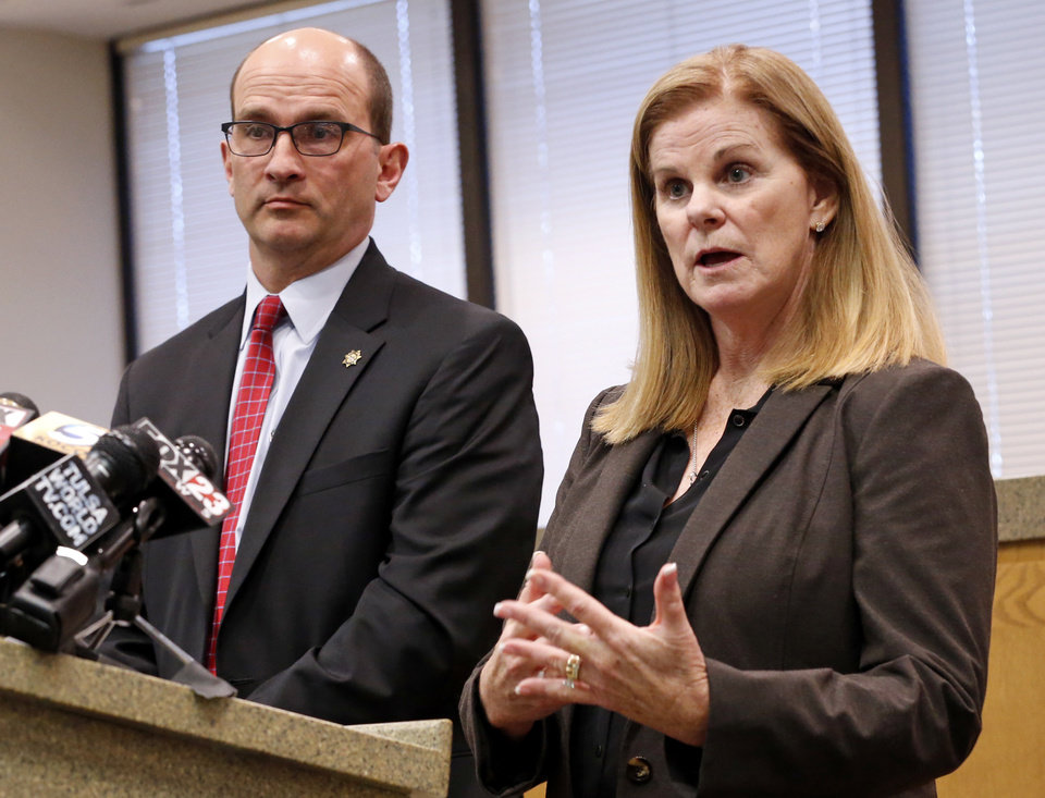 Photo - Cleveland County District Attorney Greg Mashburn and his First Assistant District Attorney Susan Caswell announce that no charges will be brought against University Of Oklahoma (OU) running back Rodney Anderson during a press conference on Thursday, Dec. 14, 2017 in Norman, Okla.  Anderson was accused of rape just days after the Big 12 Championship by a woman he met weeks earlier in a bar.  Photo by Steve Sisney, The Oklahoman