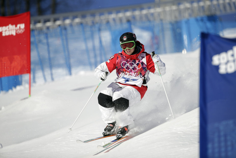 Photo - Canada's Alex Bilodeau  runs the course during freestyle skiing moguls training at the Rosa Khutor Extreme Park  ahead of the 2014 Winter Olympics, Friday, Feb. 7, 2014, in Krasnaya Polyana, Russia. (AP Photo/Andy Wong)