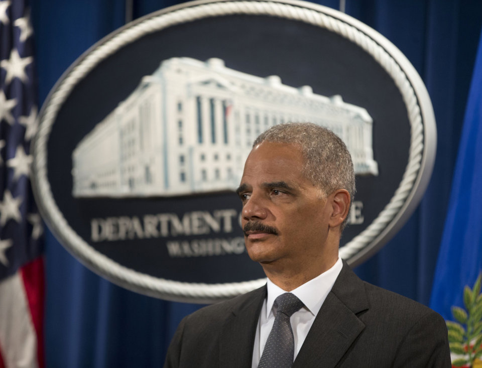 Photo - Attorney General Eric Holder participates in a news conference at the Justice Department in Washington Monday, July 14, 2014, where it was announced that Citigroup will pay $7 billion to settle an investigation into risky subprime mortgages, the type that helped fuel the financial crisis. The agreement comes weeks after talks between the sides broke down, prompting the government to warn that it would sue the New York investment bank. The bank had offered to pay less then $4 billion, a sum substantially less that what the Justice Department was asking for. The settlement stems from the sale of securities made up of subprime mortgages, which fueled both the housing boon and bust that triggered the Great Recession at the end of 2007. (AP Photo/Pablo Martinez Monsivais)
