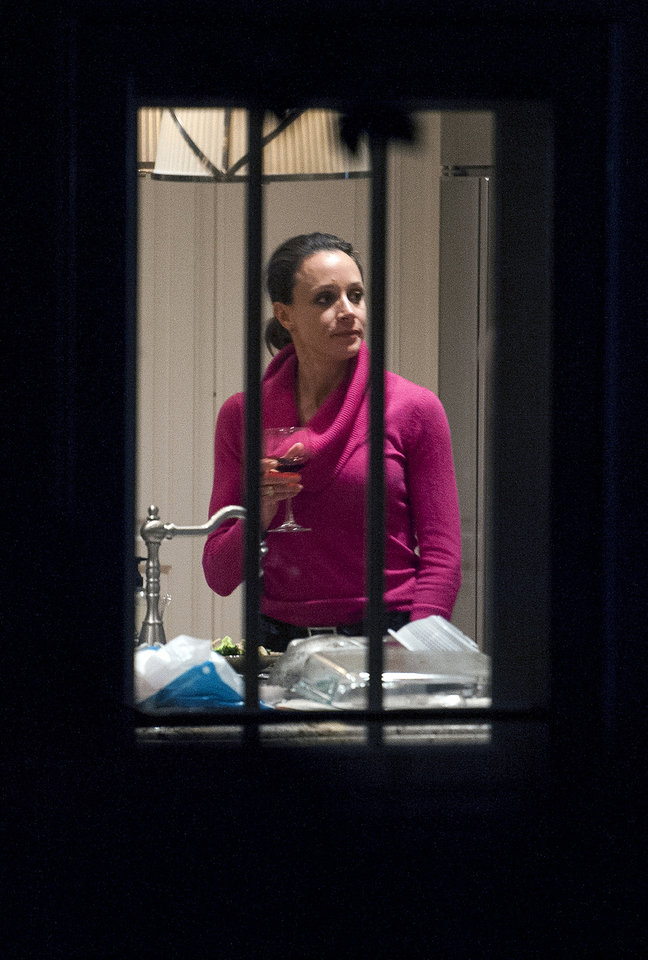 Photo -   Paula Broadwell holds a drink in the kitchen of her brother's house in Washington, Tuesday, Nov. 13, 2012. Broadwell is CIA Director David Petraeus' biographer, with whom he had an affair that led to his abrupt resignation last Friday. It was Broadwell's threatening emails to Jill Kelley, a Florida woman who is a Petraeus family friend, that led to the FBI's discovery of communications between Broadwell and Petraeus indicating they were having an affair. (AP Photo/Cliff Owen)
