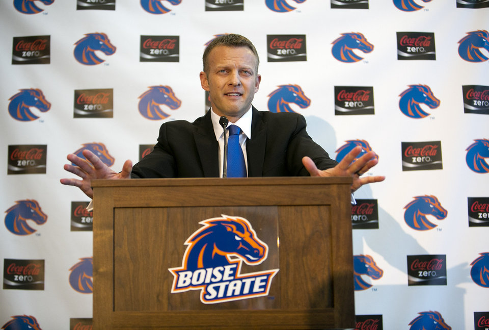 Photo - Boise State's new head coach Bryan Harsin addresses a crowd of supporters and media during his introduction at a news Conference Friday, Dec. 13, 2013, in Boise, Idaho. (AP Photo/The Idaho Statesman, Kyle Green) MANDITORY CREDIT; LOCAL TV OUT