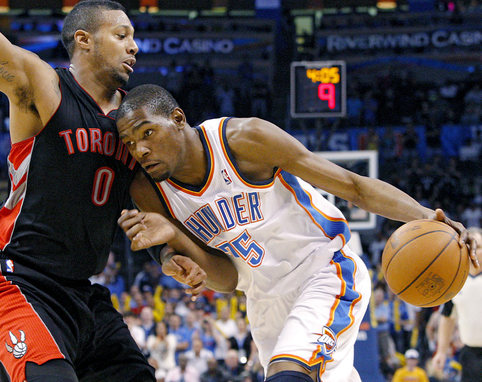 Oklahoma City\'s Kevin Durant dribbles in on Toronto\'s James Johnson during the second half of their NBA basketball game at the OKC Arena in downtown Oklahoma City on Sunday, March 20, 2011. The Raptors beat the Thunder 95-93. (Photo by John Clanton, The Oklahoman)