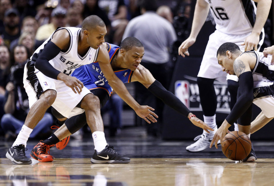 Photo - Oklahoma City's Russell Westbrook (0) fights San Antonio's Patty Mills (8) and Danny Green (4) for a loose ball during Game 1 of the Western Conference Finals in the NBA playoffs between the Oklahoma City Thunder and the San Antonio Spurs at the AT&T Center in San Antonio, Monday, May 19, 2014. Photo by Sarah Phipps, The Oklahoman