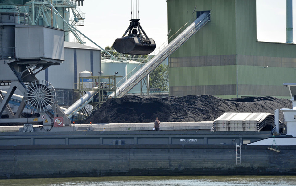 Photo - In this July 24, 2014 photo, coal is unloaded at the Trianel power plant in Luenen, Germany. The 750-megawatt power plant relies completely on coal imports, about half from the U.S. Soon, all of Germany's coal-fired power plants will be dependent on imports, with the country scheduled to halt all coal mining in 2018 when government subsidies end. As the Obama administration weans the U.S. off dirty fuels blamed for global warming, energy companies have been sending more of America's unwanted energy leftovers to other parts of the world, where they could create even more pollution. (AP Photo/Martin Meissner)
