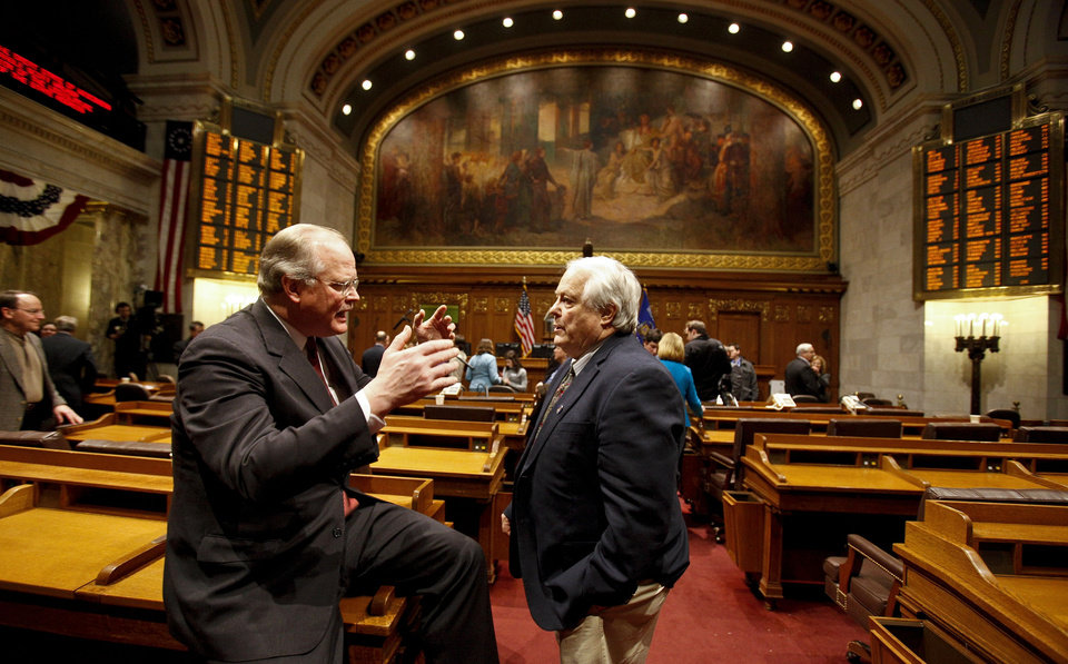 FILE - In this Jan. 25, 2012 file photo Wisconsin Sens. Dale Schultz, left, R-Richland Center and Robert Jauch, D-Poplar, confer in the Assembly chambers at the State Capitol Wednesday in Madison, Wis. The incoming speaker of the Assembly has some ideas for ending all-night sessions, which he planned to make public Tuesday, Jan. 8, 2012, before a vote Thursday that could itself go all night. (AP Photo/Andy Manis, File)