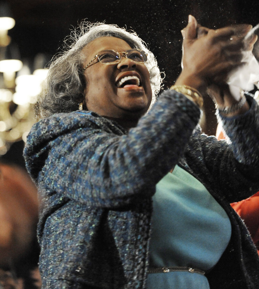 Photo - Juanita Abernathy, widow of civil rights leader Ralph Abernathy, celebrates while watching a live video feed of President Barack Obama's inauguration after speaking at the Union League Club of Chicago in Chicago, Monday, Jan. 21, 2013. Ralph Abernathy was Martin Luther King's friend and with him from the beginning of the Civil Rights Movement until the time he was killed. (AP Photo/Paul Beaty) ORG XMIT: ILPB101