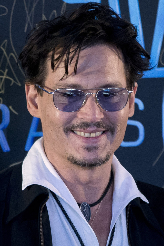 """Photo - Actor Johnny Depp attends a promotional event for his new movie """"Transcendence"""" in Beijing, China, Monday, March 31, 2014.  Johnny Depp showed off a diamond engagement ring that he called a """"chick's ring"""" on Monday, indirectly confirming rumors of his engagement to actress Amber Heard. (AP Photo/Alexander F. Yuan)"""