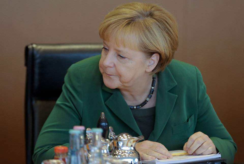 Photo - German Chancellor Angela Merkel attends the last cabinet meeting prior to the national elections at the chancellery in Berlin, Wednesday, Sept. 18, 2013. Germany faces general elections on Sept. 22, 2013 where Chancellor and Christian Democratic Union, CDU, party chairwoman Merkel will run for her third term . (AP Photo/Markus Schreiber)