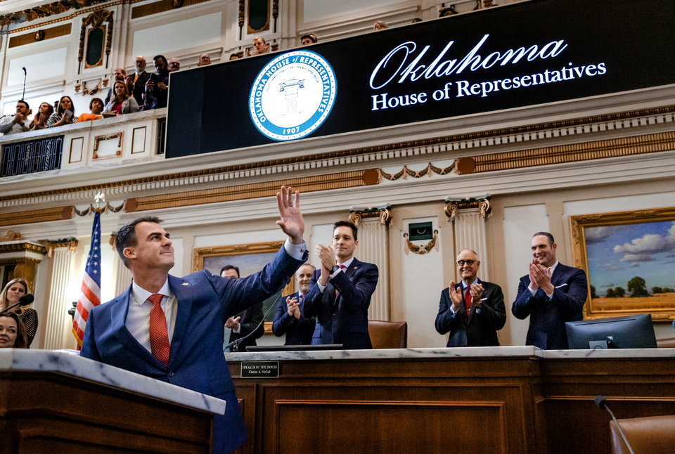 Photo - Gov. Kevin Stitt waves to the gallery as he begins his State of the State Address in the House Chambers of the Oklahoma House of Representative in Oklahoma City, Okla. on Monday, Feb. 3, 2020.  [Chris Landsberger/The Oklahoman]