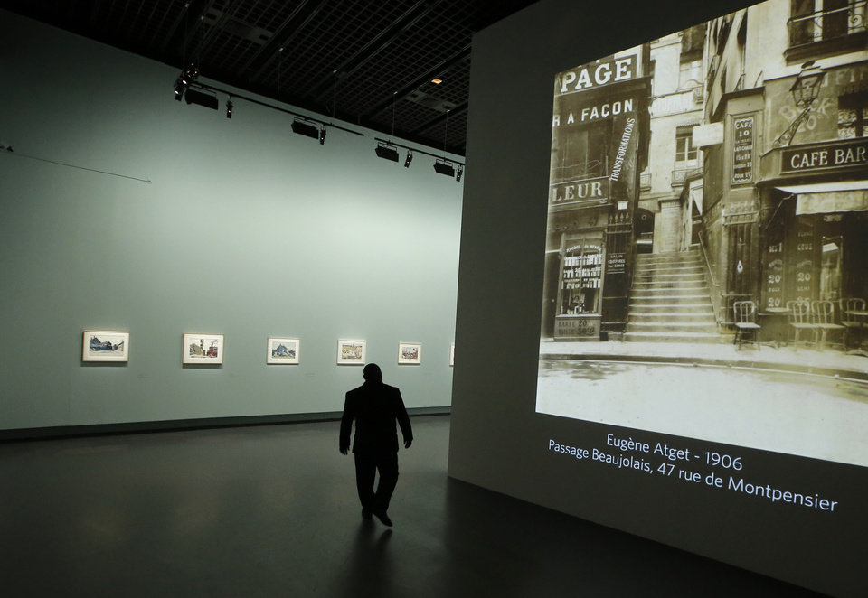 A man walks by a Eugene Atget photography display as part of the retrospective for Edward Hopper, one of the great American 20th century artists at Paris� Grand Palais Museum, in Paris, Monday, Oct. 8, 2012. This major Hopper retrospective reveals that the 20th century painter known for his rendering of American life, also drew inspiration from France, and includes some 128 Hopper works, such as the masterpieces �Nighthawks� and �Soir Bleu�.(AP Photo/Francois Mori)