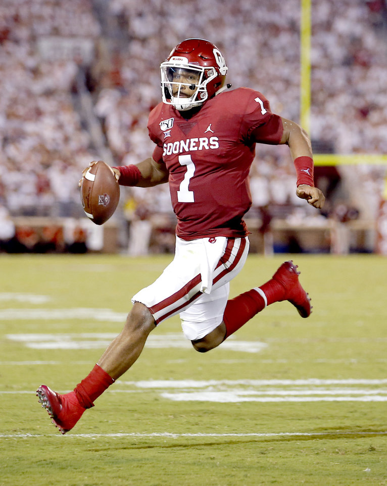 Photo - Oklahoma's Jalen Hurts (1) rushes for a touchdown in the third quarter during a college football game between the University of Oklahoma Sooners (OU) and the Houston Cougars at Gaylord Family-Oklahoma Memorial Stadium in Norman, Okla., Sunday, Sept. 1, 2019. [Sarah Phipps/The Oklahoman]