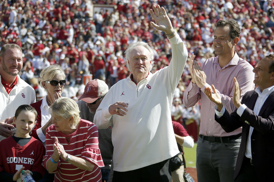 Photo - Steve Owens waves to the crowd as he is honored on the 50th anniversary of his Heisman Trophy during halftime of a college football game between the University of Oklahoma Sooners (OU) and the West Virginia Mountaineers at Gaylord Family-Oklahoma Memorial Stadium in Norman, Okla, Saturday, Oct. 19, 2019. Oklahoma won 52-14. [Bryan Terry/The Oklahoman]