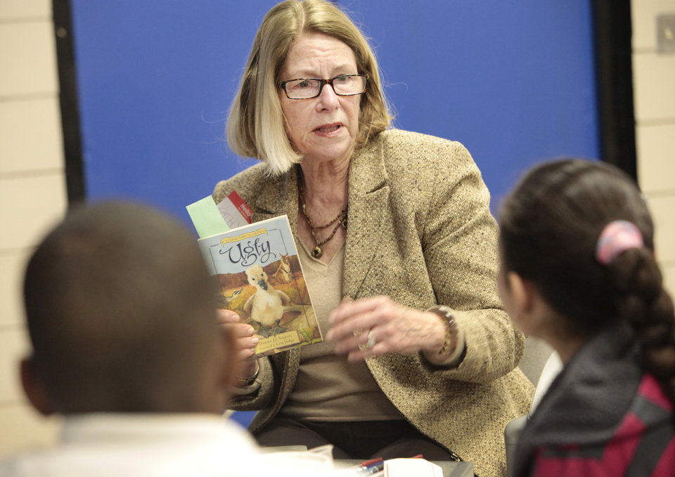 "Photo -      Kathy Walker, from the Reading Club, reads ""Ugly"" to fifth-graders at Stanley Hupfeld Academy on Thursday. Photo by David McDaniel, The Oklahoman   David McDaniel -  The Oklahoman"