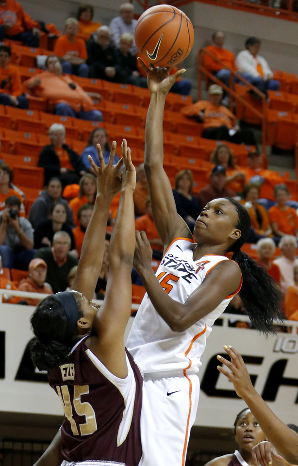 Photo - Oklahoma State's Toni Young (15) shoots the ball over Texas State's Ashley Ezeh (45) during a women's college basketball game between Oklahoma State University and Texas State at Gallagher-Iba Arena in Stillwater, Okla., Wednesday, Nov. 28, 2012.  Photo by Bryan Terry, The Oklahoman