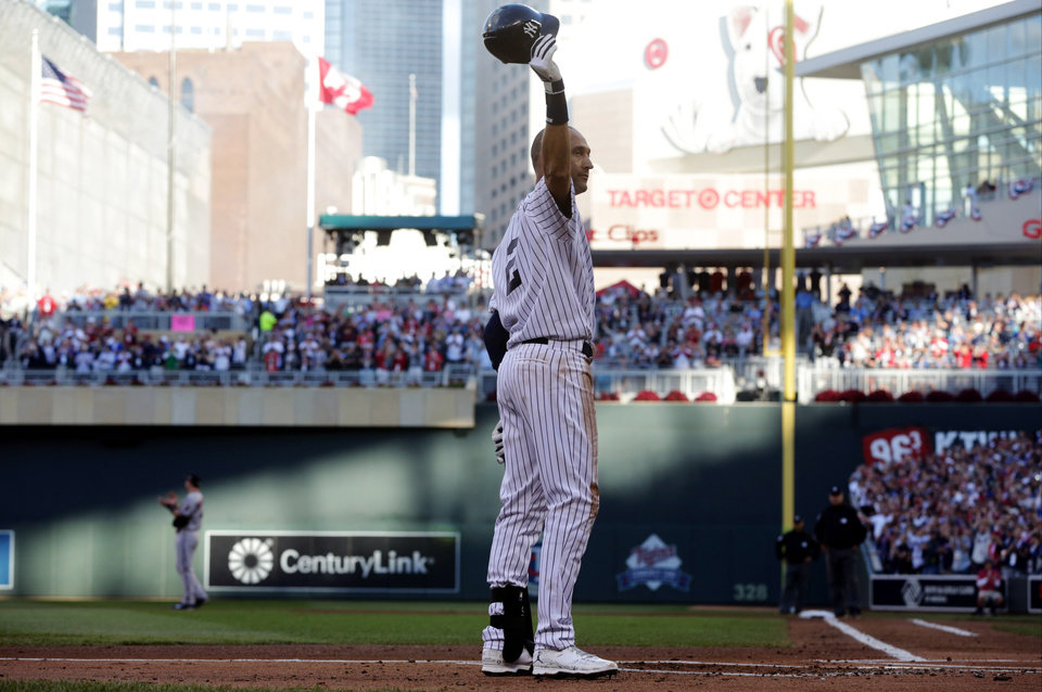 Photo - Shortstop Derek Jeter, of the New York Yankees, waves to the crowd during the first inning of the MLB All-Star baseball game, Tuesday, July 15, 2014, in Minneapolis. (AP Photo/Jim Mone)
