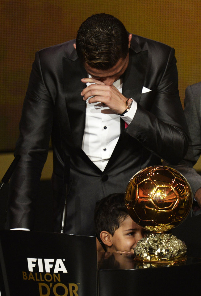Photo - Cristiano Ronaldo of Portugal cries as he is awarded the prize for the FIFA Men's soccer player of the year 2013 at the FIFA Ballon d'Or 2013 gala at the Kongresshaus in Zurich, Switzerland, Monday, Jan. 13, 2014. (AP Photo, Keystone/Steffen Schmidt)