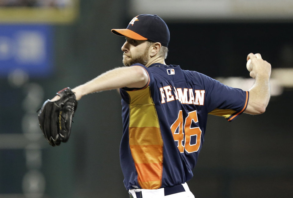 Photo - Houston Astros' Scott Feldman pitches against the Detroit Tigers in the first inning of a baseball game Sunday, June 29, 2014, in Houston. (AP Photo/Pat Sullivan)