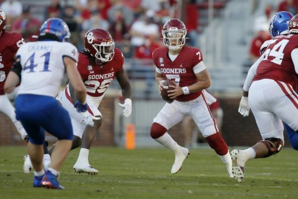 Photo -  OU quarterback Spencer Rattler (7) looks to pass during a 62-9 win over Kansas on Nov. 7 in Norman. [Bryan Terry/The Oklahoman]
