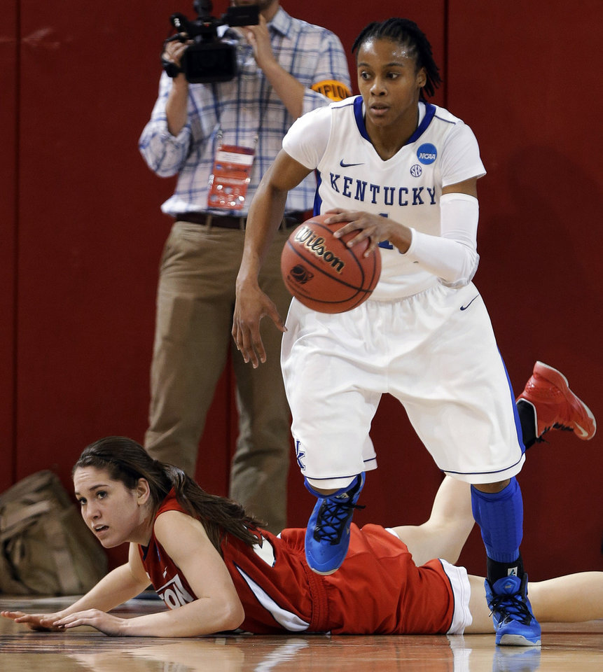 Kentucky\'s A\'dia Mathies dribbles away from Dayton\'s Kelley Austria in the second half of a second-round game in the NCAA women\'s college basketball tournament Tuesday, March 26, 2013, in New York. Kentucky won 84-70. (AP Photo/Frank Franklin)