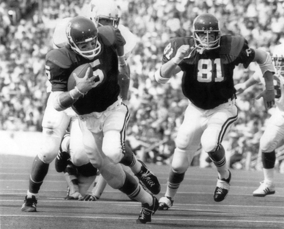 Photo - OU FOOTBALL:  University of Oklahoma quarterback Steve Davis takes off on his 22-yard touchdown scamper for the Sooners first touchdown in second quarter action against Texas in the Coton Bowl college football game Saturday, 10/12/74.  The Sooners downed the Longhorns, 16-13.   Staff photo by Jim Argo taken 10/12/74.    File:  Football/OU/OU-Texas/Steve Davis/1974