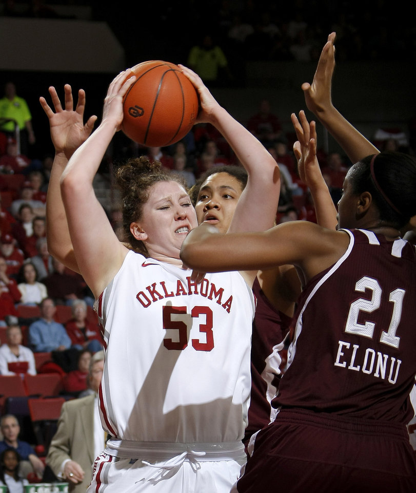 Photo - OU's Joanna McFarland (53) fights with Texas A&M's Danielle Adams (23) and Texas A&M's Adaora Elonu (21) during the Big 12 women's basketball game between the University of Oklahoma and Texas A&M at Lloyd Noble Center in Norman, Okla., Wednesday January 26, 2011.  Photo by Bryan Terry, The Oklahoman
