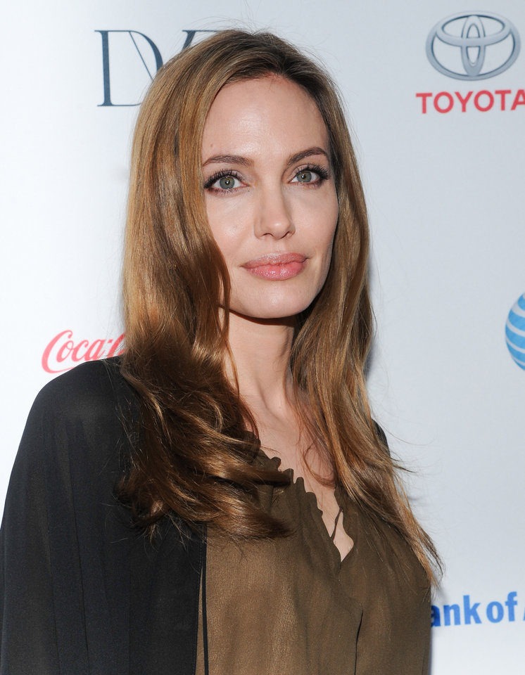 Photo - Actress Angelina Jolie attends the 4th Annual Women in the World Summit at the David H. Koch Theater on Thursday April 4, 2013 in New York. (Photo by Evan Agostini/Invision/AP)