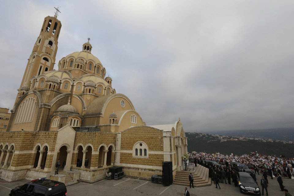 Photo -   The convoy of Pope Benedict XVI, right, arrives at St. Paul's Basilica to sign the post-Synodal Apostolic Exhortation of the special assembly for the Middle East of the Synod of Bishops, in Harissa east of Beirut, Lebanon, Friday Sept. 14, 2012. Pope Benedict XVI arrives to Lebanon for a three day visit to encourage his flock in the Middle East. He will also meet with Lebanese authorities as well as Christians from Lebanon and other nearby countries. (AP Photo/Hussein Malla)