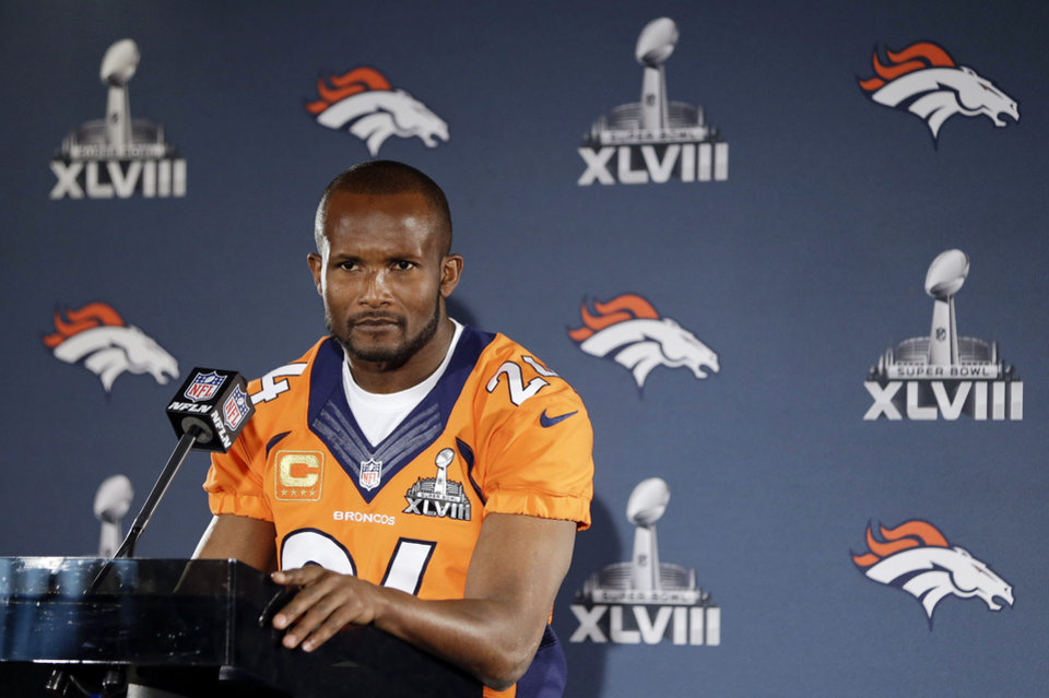 Photo - FILE - In this Jan. 29, 2014, file photo, Denver Broncos cornerback Champ Bailey listens to a question during a news conference in Jersey City, N.J. Bailey has agreed to a two-year contract with the New Orleans Saints, Friday, April 4, 2014. The 35-year-old Bailey played the last 10 seasons with Denver after spending his first five in the NFL with Washington. (AP Photo/Mark Humphrey, File)