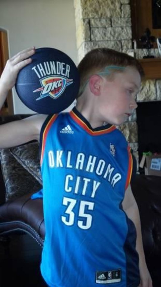 7-year-old TJ shows his Thunder pride with a thunder bolt haircut.