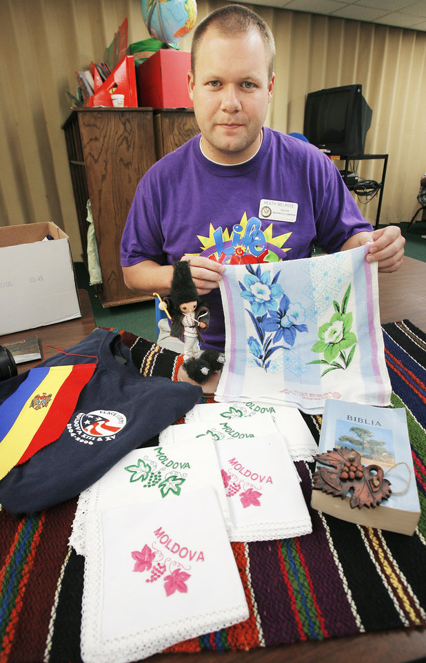 Photo - Heath Melrose with things he brought back from Moldova in his classroom at Northern Hills Elementary School in Edmond, Monday, October 9, 2006. Melrose recently returned from a two-year stint teaching in Moldova with the Peace Corps.    BY DAVID MCDANIEL, THE OKLAHOMAN     ORG XMIT: KOD