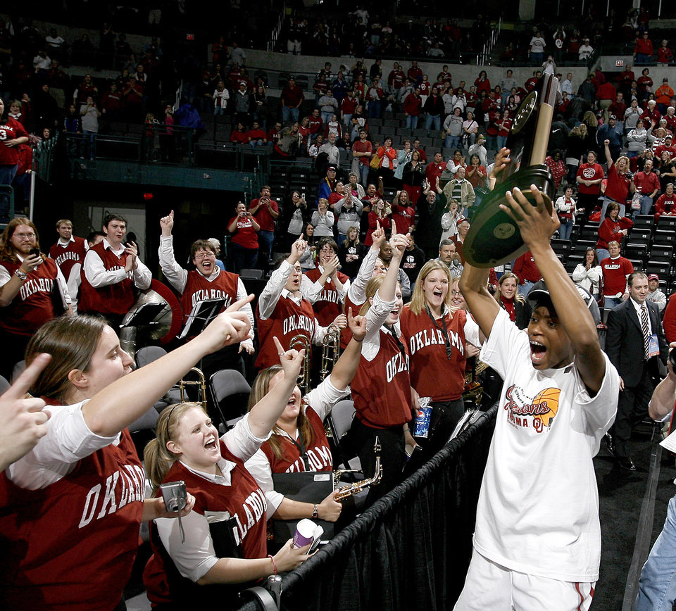 Photo - OU's Nyeshia Stevenson celebrates after OU's win during the NCAA women's basketball regional  tournament finals between Oklahoma and Purdue at the Ford Center in Oklahoma City, Tuesday, March 31, 2009. OU won, 74-68.  Photo by Bryan Terry, The Oklahoman