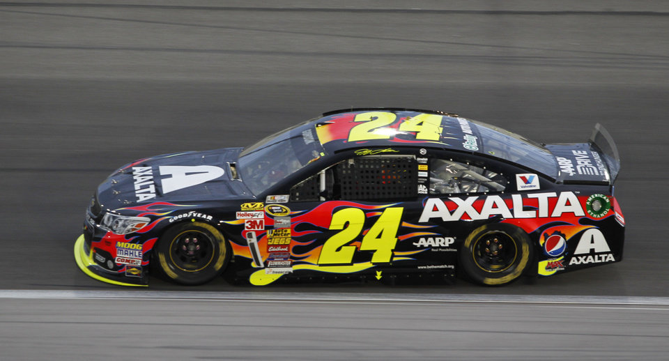 Jeff Gordon (24) takes a lap during a NASCAR Sprint Cup Series auto race at Kansas Speedway in Kansas City, Kan., Saturday, May 10, 2014. (AP Photo/Colin E. Braley)