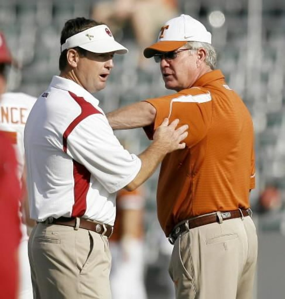 Photo - OU coach Bob  Stoops and Texas coach Mack  Brown meet before the college football game between the University of Oklahoma Sooners (OU) and University of Texas Longhorns (UT) in the Red River Rivalry on Saturday, Oct. 11, 2008, at the Cotton Bowl, in Dallas, Tx. BRYAN TERRY