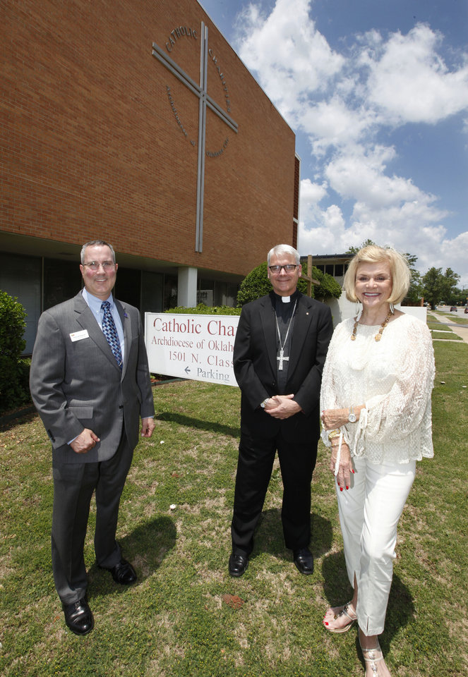 Photo -  Patrick Raglow, left, executive director of Catholic Charities, Oklahoma City Archbishop Paul S. Coakley, and Crossbeam campaign Co-chairman Judy Love talk in front of the current Catholic Charities home at 1501 N Classen Boulevard in Oklahoma City, OK, Thursday, May 29, 2014, Photo by Paul Hellstern, The Oklahoman   PAUL HELLSTERN -  Oklahoman