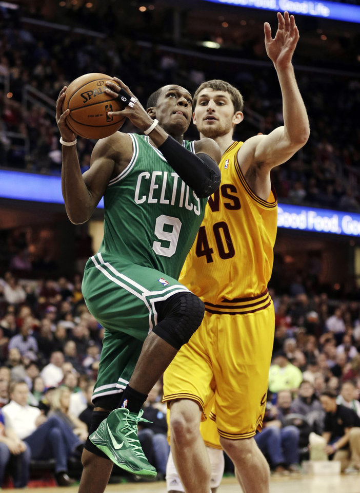 Boston Celtics' Rajon Rondo (9) drives to the basket against Cleveland Cavaliers' Tyler Zeller (40) during the first quarter of an NBA basketball game, Tuesday, Jan. 22, 2013, in Cleveland. (AP Photo/Tony Dejak)