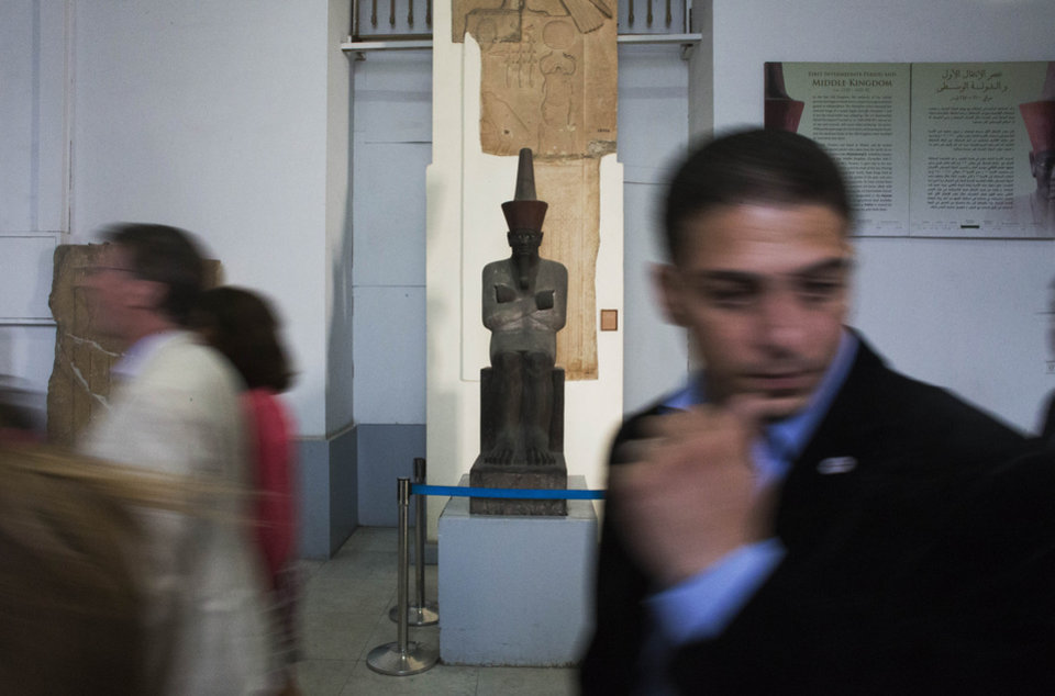Photo - Guests participate in a tour at the Egyptian Museum after its renovation project announcement in downtown Cairo, Egypt, Friday, Nov. 15, 2013. Egypt unveiled Friday an ambitious renovation project for its Cairo's famed Egyptian Museum, in a bid to show that the Arab world's most populous country was regaining a sense of normalcy after months of unrest. (AP Photo/Hiro Komae)